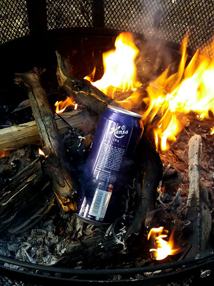 Twigs in a can in the fire.